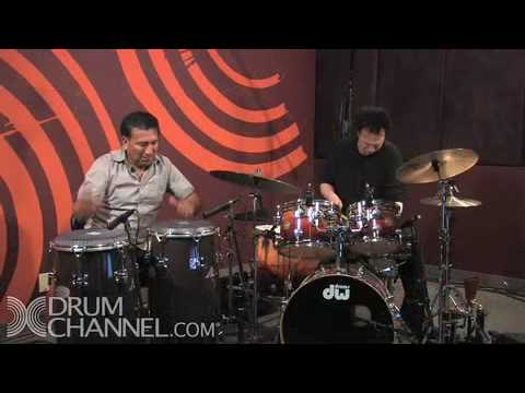 Alex Acuna and Terry Bozzio give a short lesson in drumming rudiments, both on snare and conga, then play a short jam incorporating these elements.