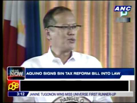 Aquino signs sin tax reform into law
