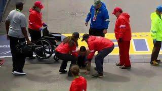 Image of marine crawling across finish line at Boston Marathon captures attention of millions