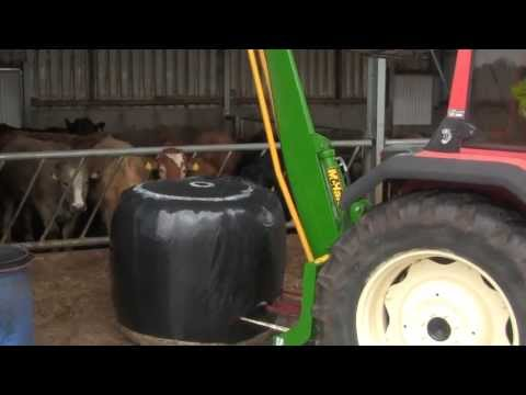 Feeding silage with Same Explorer & McHale 994 Round Bale Splitter 2013