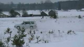 Subaru Forester and Nissan Pathfinder drift on snow