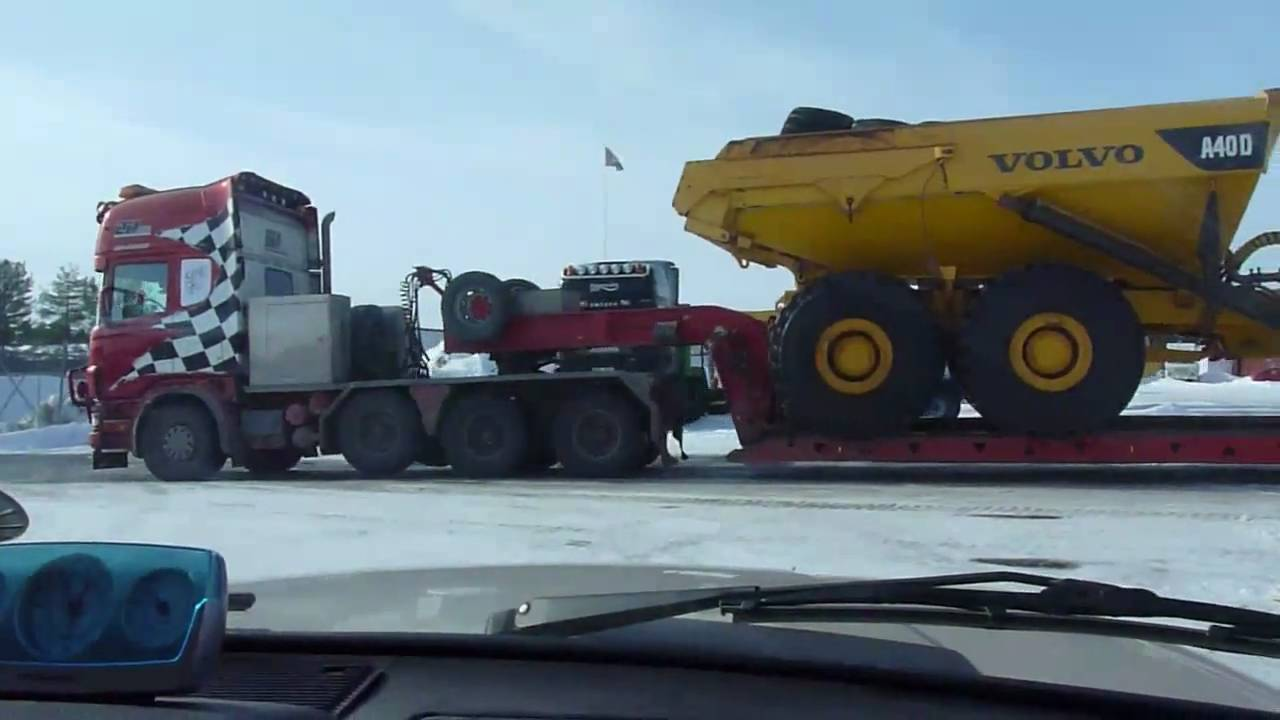 Scania R164 V8 580 8x4 Heavy haulage with a Volvo A40D ADT Maskintransport - YouTube