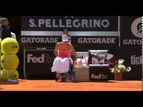 Ball Boy trips behind Sharapova