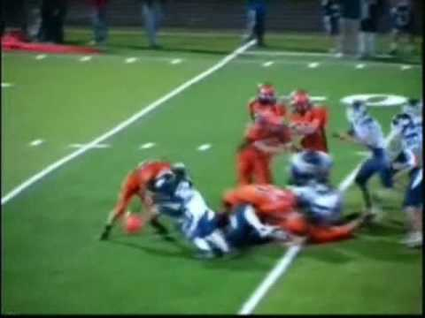 The ball carrier get hit and ends up with the other teams helmet on his head instead of his own.