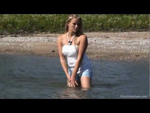 Britt In Hot Pants And Blouse Gets Wet video