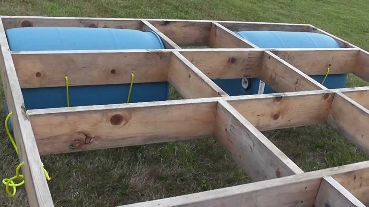 Building a floating raft (using barrels) with children's slide - YouTube