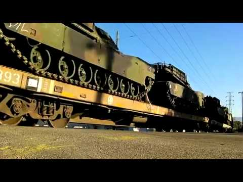 Martial Law? Military Tanks on Train