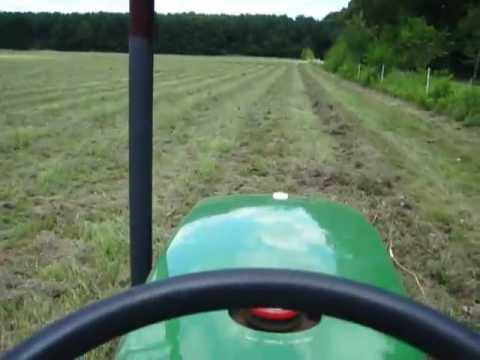 Hay-making time!  New Holland Rolabar rake pulled by John Deere 790
