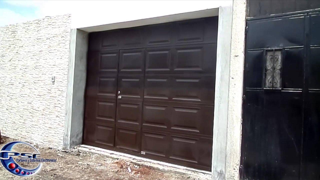 Porton seccional de garaje con puerta peatonal guatemala for Modelos de puertas y precios