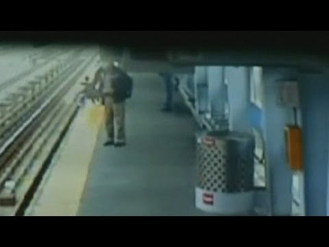 Dramatic CCTV: Baby in stroller falling onto train tracks in Philadelphia caught on camera