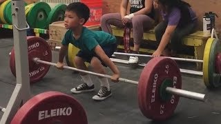 Kids do olympic weightlifting