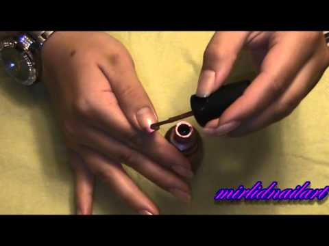 Bow with pawprint and chewingbone nail art tutorial