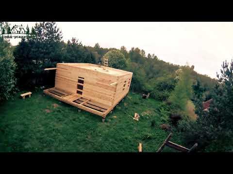 Видео строительства дома из бруса под усадку