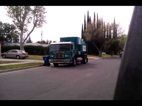 L.A City Amrep picking a Trash Container up.