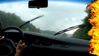 Driving into a heavy rain storm.