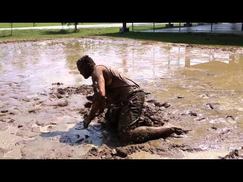Preteen man in mud