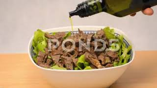 Olive Oil Poured Over Meat Salad - Stock Footage