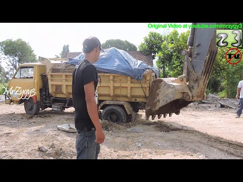 Dump Truck Stuck Recovery By Volvo EC210B Excavator