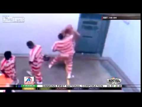LiveLeak com   Alleged child molester gets his face smashed in jail