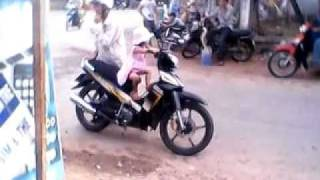 two years girl ride motobike.avi