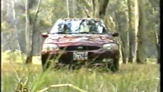 FORD ESCORT GHIA 1.8 ZETEC 16V. (1997) TEST AUTO AL DÍA.