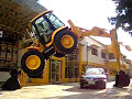 Car passing under the JCB 4CX backhoe loader