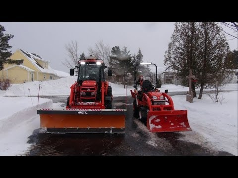 Me. wifey.the Kubota BX25D & 5740 snow clearing