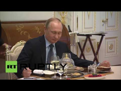 Russia: Putin welcomes Sarkozy ahead of St. Petersburg Economic Forum