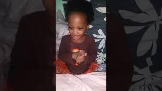 Toddler singing nursery songs