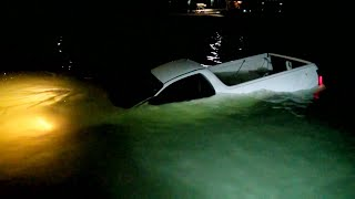 CAR FLOATS PAST BOAT AND SINKS - Straya