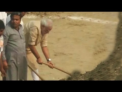 PM Modi with spade cleans Assi Ghat in Varanasi