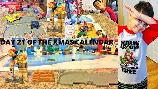 DAY 21 ON THE CHRISTMAS ADVENT CALENDAR. LEGO CITY, HOT WHEELS, & DISNEY CARS.