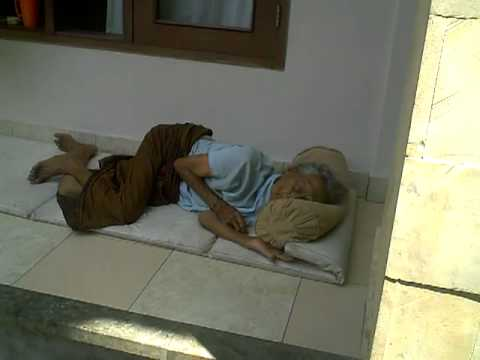 Cute Old Indonesian woman sleeping outdoors at her home. beautiful.....