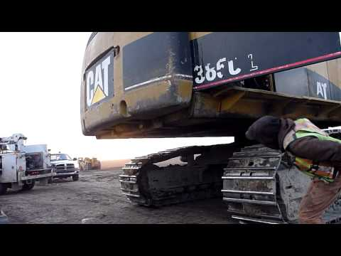 Installing a Counterweight on a Cat 385C L Excavator
