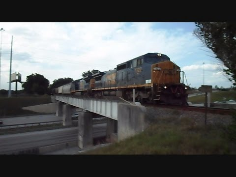 CSX Train Over A Bridge And Through A Crossing To The Railroad Yard We Go