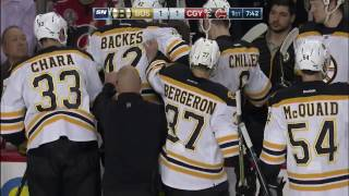 Backes has to be helped off ice after awkward fall into boards