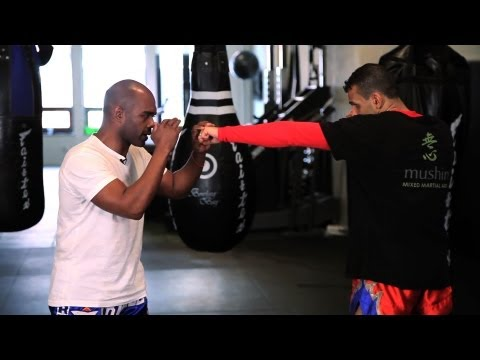 How to Defend Against Punches in Kickboxing | Muay Thai Kickboxing | MMA Image 1