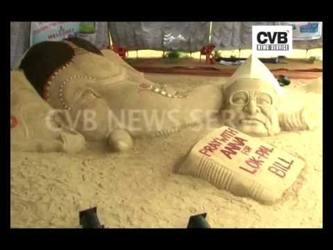 SUDARSHAN PATNAIK CARVES ANNA AND GANESHA OUT OF SAND