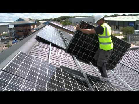 Solar Installers Installing 8kWp Commercial Solar PV System at Product Perceptions, Crawley