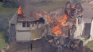 Burning down the house: Texas family burn down luxury home that hangs over 75ft cliff