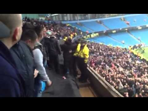 Fletcher and ashley young in with united fans away at city