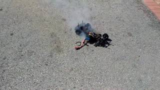 Hpi sprint. 2 flux on fire rc car fail.  Lipo blew up. ( why not to shuve a 3s in sprint 2 )