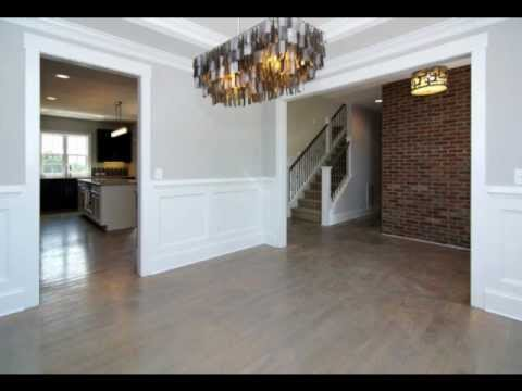 Formal Dining Room Features Trey Ceilings Wainscoating