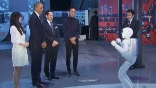 President Obama plays soccer with a robot
