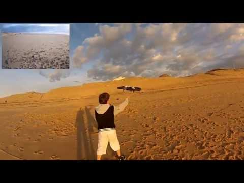 AR Drone 2.0 Attaqué par un Chien à la plage HD ( Iphone 5. Ipad + Gropro Hero 3 )