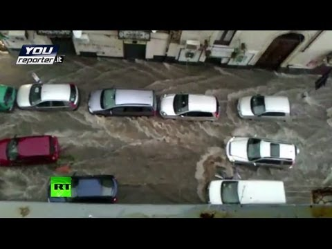 Flood video: Streets turned into rivers as heavy rains swamp Italy & Greece