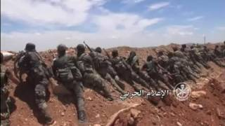 Syrian army video shows fighting around Khan al-Shih.