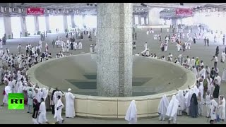 Muslim worshippers stoning devil during Hajj pilgrimage