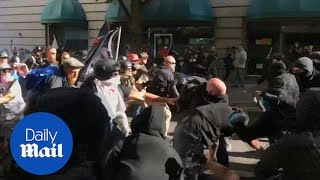 Fight breaks out between opposing protests in Portland - Daily Mail
