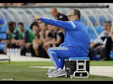 Marseille manager Marcelo Bielsa sits on cup of coffee during 2-0 win over Toulouse